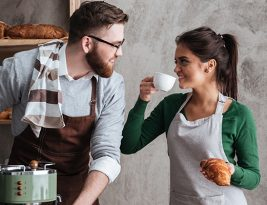 Cheerful Loving Couple Bakers Drinking Coffee